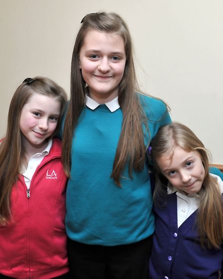 3 sisters having hair cut for Little Princess trust and also to raise money for Billy lee charity. L