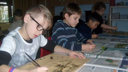 Pupils enjoyed an action-packed Stone Age day