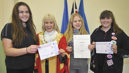 At Ely Beet Club, are 1st Ely Guides receiving medals, (l-r) Saskia Winkle, with her Baden Powell aw