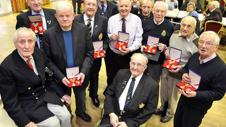 At Ely Beet Club, Members of the Ely & District Branch of the Korean Veterans Association, receive t