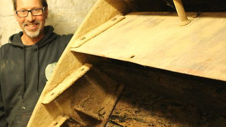 Millwright, Neil Medcalf, removes the 300-year-old buckets from Sacrewell mill waterwheel.