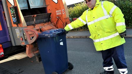Cllr Alan Melton covering a shift as a refuse collector in 2010, when he was leader of the council.