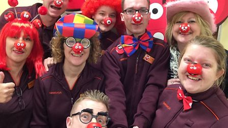 Staff at Sainsbury's in Ely entering into the Red Nose Day spirit