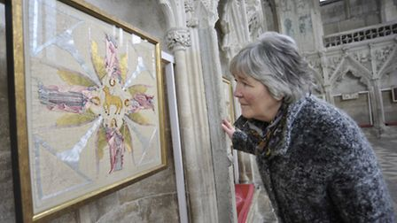 Volunteer Mary Finney looks at one of the exhibits. Picture: HELEN DRAKE