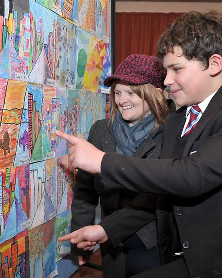 Art and music exhibition Cromwell Community College, Chatteris. Finley showing mum Melanie his art