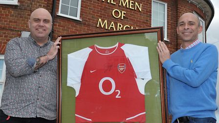 Arsenal shirt being raffled for March soccer school. Left:Keith Foose and Stuart Toman with Arsenal