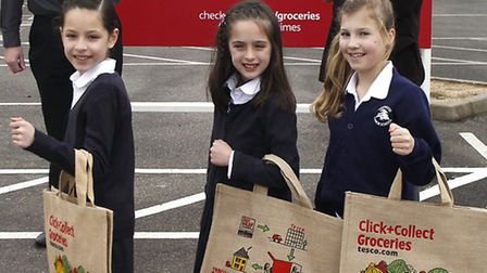 Karyn showing off the winning design on specially printed shopping bags with her sister Jenny left