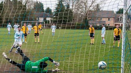 Ross Alexander tucks away a penalty for Chatteris at Hemingfords. Picture: Chatteris Town Football C