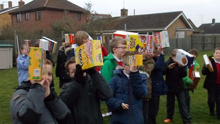 Pupils put their eclipse viewers into action at Little Thetford Primary School.