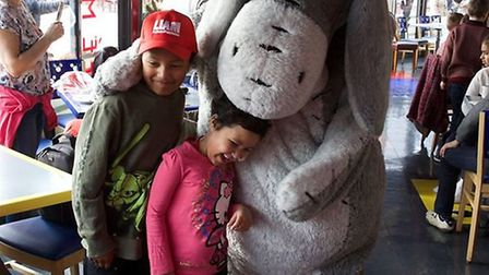 Youngsters enjoy a cuddle with Eeyore at Disneyland thanks to the Liam Fairhhurst Foundation