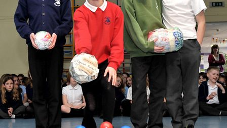 Egg Skittles challenge Westwood School, March.Year 6 pupils ready to have a go at knocking the skitt