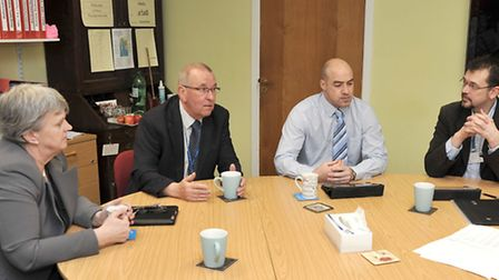 Catherine Jenkinson-Dix and some of her team in 2013 discussing some of the college's achivements wi