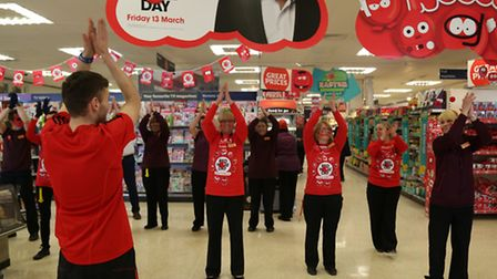 Staff stopped work and danced for a couple of minutes to raise cash.