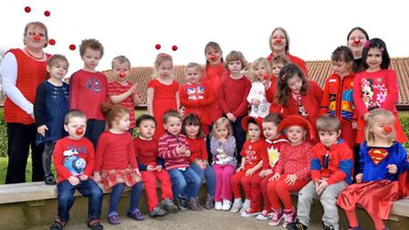 Children and staff at Goslings Pre-School wore red to raise money for Comic Relief.