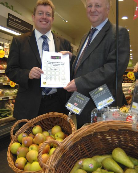 Sir Jim presenting the Parliamentary Small Shops award to Jonathan James, when he owned Budgens in S