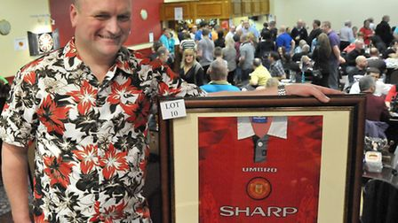Mark Cross at last year's event with one of the auction lots. Picture: Steve Williams.