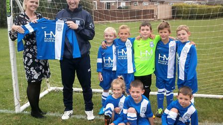 Harrison Murray manager Nicola Roberts and Under 8s Blues team manager Matt Christian and some of th