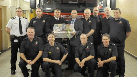 Watch Commander Mark Edgley being presented with hamper by Firefighters Charity Sales Manager Kevin