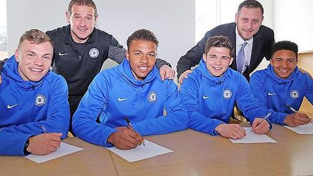 Jack Friend (second from right) signs his pro deal. Picture: Joe Dent.