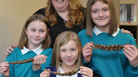 3 sisters having hair cut for little princess trust and billy lee charity, at Reflections hairdresse