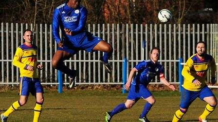 Mike Ogboin leaps for a header. Picture by Jamie Pluck
