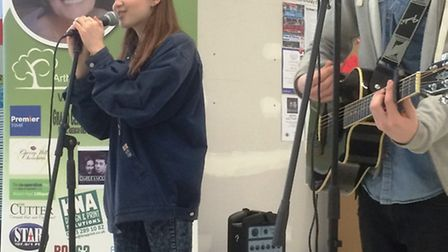Charlie and Molly perform at Sainsbury's, in Ely.