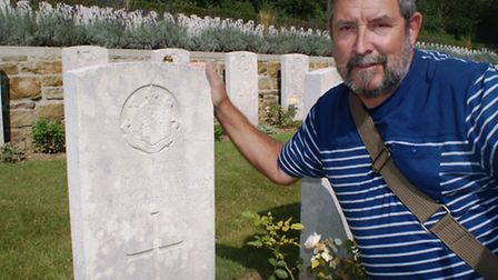 Ian McGee at the grave of his great uncle Thomas Parker McGee, who died in the First World War.