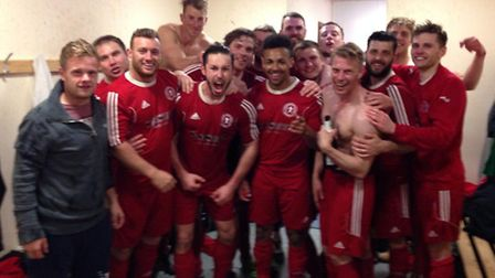 Doddington United celebrate in the changing rooms after winning Kershaw Senior B.