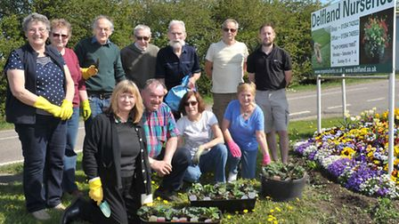 March in Bloom volunteers planting hanging baskets and railing planters at Delflands Nurseries.Pictu