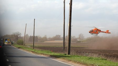 The helicopter leaving the scene of the crash. Picture: TED JOHNS