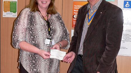 Amanda Newman, manager of the March Centre, receiving the donation from president Godfrey Smith. Pic