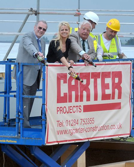 Topping out ceremony. New Tesco foodstore at Chatteris.Left: Cllr Alex Miscandlon, Liz Dent from Den