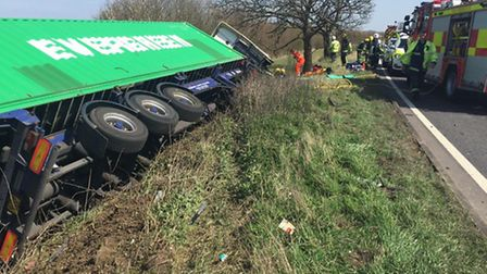 The lorry on its side off the A428. Picture: BCH ROAD POLICING