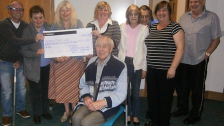 Pat and Kevin Stenton handing over the cheque to Patricia Spriggs and Gillian Sadler from the Wisbec