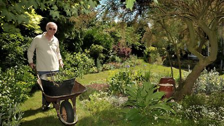 George Payne puts the finishing touches to his garden at Middle Road, March in a previous open garde