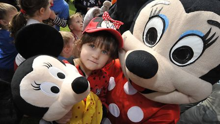 Inflatable fun with a bungee run, at Littleport Leisure Centre, with Mickey and Minnie Mouse, Layla,