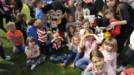 Inflatable fun with a bungee run, at Littleport Leisure Centre, with Mickey and Minnie Mouse,
