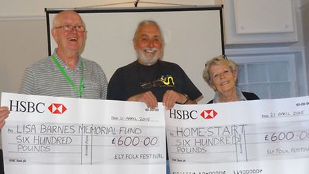 Andy Wall, chairman of the folk festival committee, presented cheques totalling £1,200 to Sheila Abb