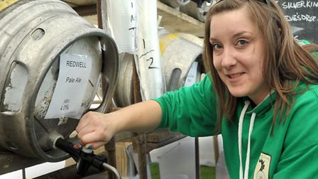 Kelly Woodroffe pulling pints at last year's Wicken Beer Festival. Picture: Steve Williams.