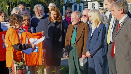 Jane Howell and 38Degress hand the petition over to SE Cambridgeshire election hopefuls.