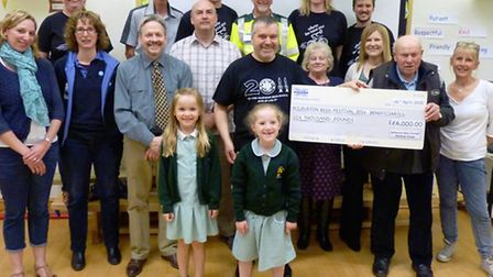 The beer festival committee hands over money to good causes.