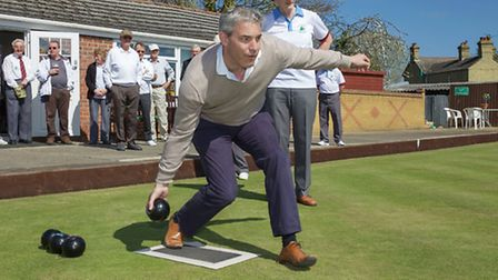 Steve Barclay bowls the first wood. Picture: Barry Giddings.