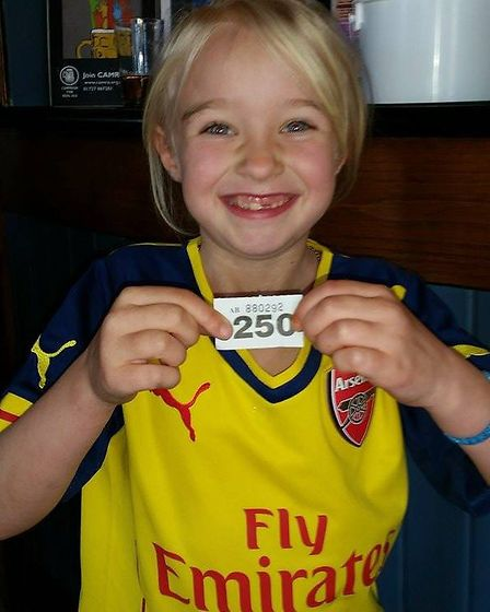 Harriet pulls the winning ticket for the Arsenal shirt