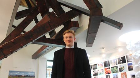 Max Openshaw with his sculpture, entitled Construction.