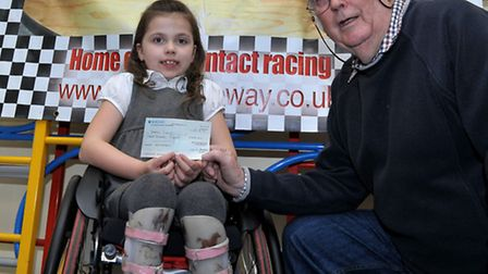 Cheque presentation to Chloe Lewis by March Raceway RC club chairman Mike Chilvers,