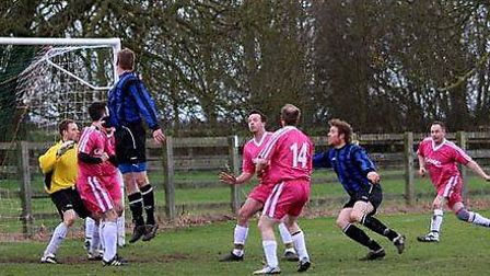 March Soccer School coaches took on a Manea side in a charity match.