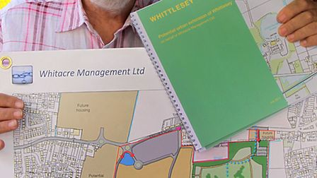 Bruce Smith pictured in 2011 with plans for the Sainsbury's store and country park.