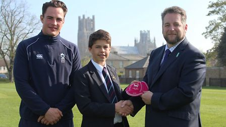 Jason Billows, head of Rugby, and Richard Whymark, head of King's Ely Junior, presenting Callum his