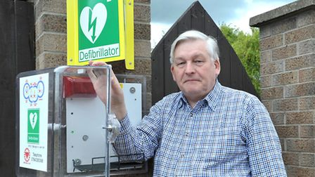 Charity trustee Alan Sharkey with the empty defibrillator box. Picture: STEVE WILLIAMS