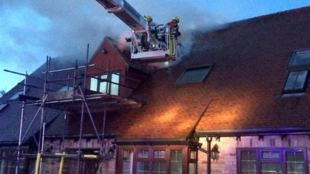 Firefighters tackling the blaze. Picture: CAMBS FIRE AND RESCUE SERVICE.